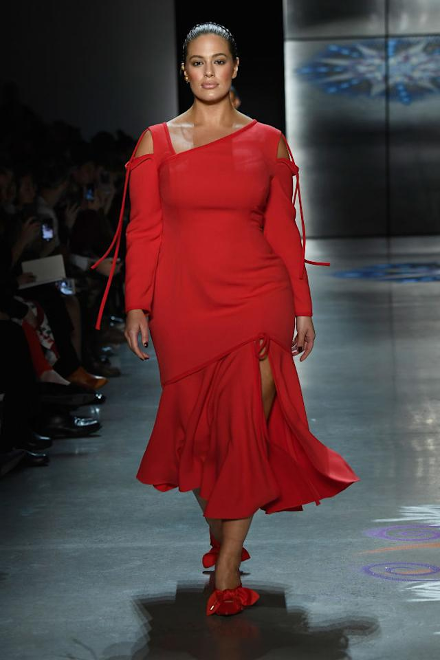 <p>She hit the runway in a red dress, satin shoes, and pulled back pony. (Photo: Getty Images) </p>