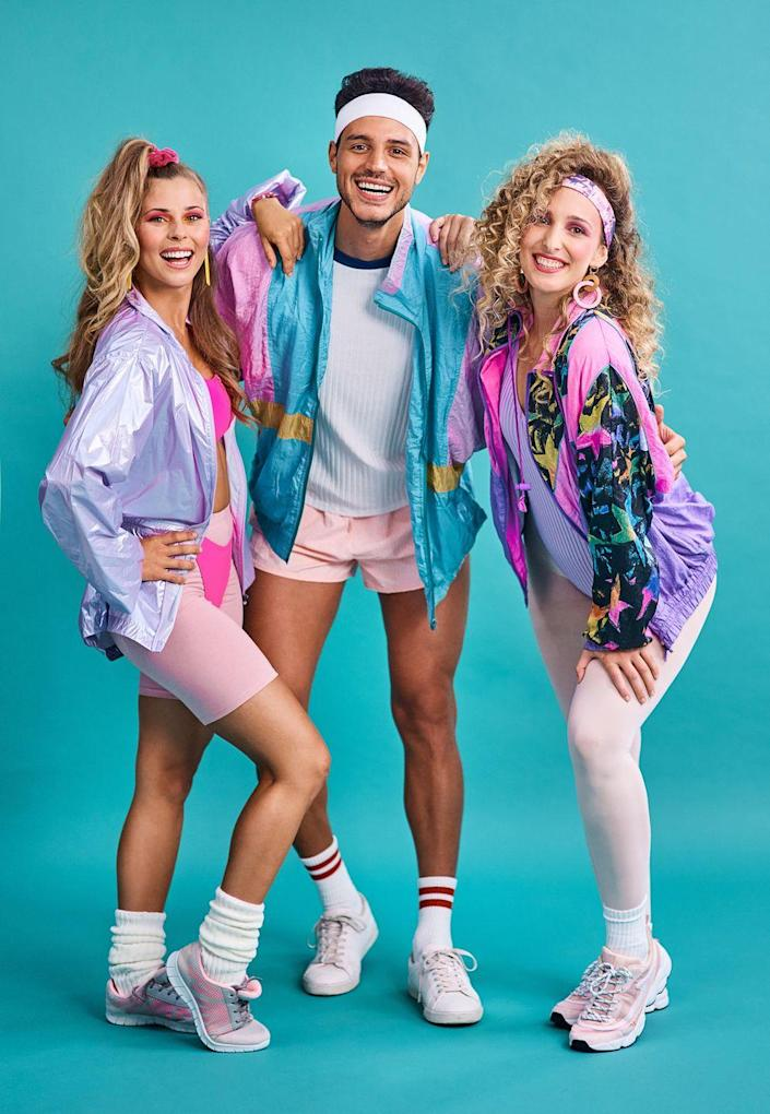 """<p>Feeling like a maniac? Then find all the pastel spandex you can and transform your squad into '80s aerobics fanatics. </p><p><a class=""""link rapid-noclick-resp"""" href=""""https://www.amazon.com/Allegra-Holographic-Fashion-Metallic-Lightweight/dp/B07RHRMLJ9?tag=syn-yahoo-20&ascsubtag=%5Bartid%7C10070.g.3083%5Bsrc%7Cyahoo-us"""" rel=""""nofollow noopener"""" target=""""_blank"""" data-ylk=""""slk:SHOP WINDBREAKERS"""">SHOP WINDBREAKERS</a></p>"""