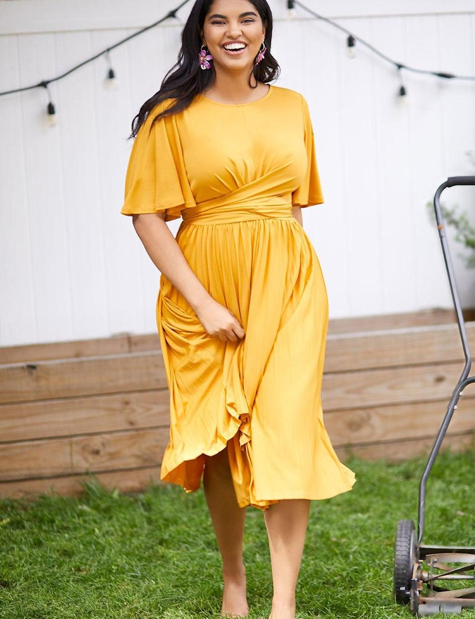 """Get <a href=""""https://www.eloquii.com/plus-size-new-arrivals"""" rel=""""nofollow noopener"""" target=""""_blank"""" data-ylk=""""slk:50% off select styles"""" class=""""link rapid-noclick-resp"""">50% off select styles</a> on Monday using checkout code ONEDAY. <br> <br> <strong>Eloquii</strong> Wrap Dress with Pleated Skirt, $, available at <a href=""""https://go.skimresources.com/?id=30283X879131&url=https%3A%2F%2Fwww.eloquii.com%2Fwrap-dress-with-pleated-skirt%2F1228446.html%3Fdwvar_1228446_colorCode%3D25"""" rel=""""nofollow noopener"""" target=""""_blank"""" data-ylk=""""slk:Eloquii"""" class=""""link rapid-noclick-resp"""">Eloquii</a>"""