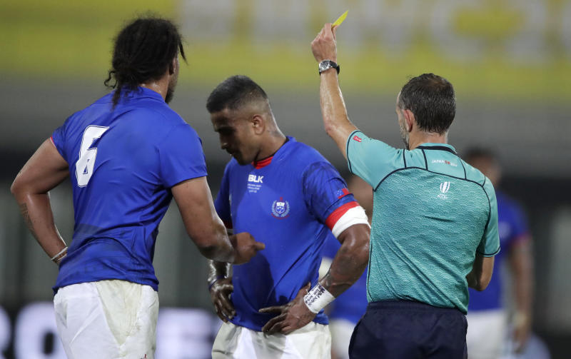 CORRECTS NAME OF PLAYER RECEIVING YELLOW CARD Referee Romain Poite shows Samoa's Rey Lee-lo, centre, a yellow card during the Rugby World Cup Pool A game between Russia and Samoa at Kumagaya Rugby Stadium, Kumagaya City, Japan, Tuesday, Sept. 24, 2019. (AP Photo/Jae Hong)