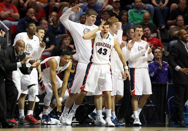 SAN DIEGO, CA - MARCH 21: Drew Barham #43 and other players on the bench of the Gonzaga Bulldogs cheer for their team during their game Oklahoma State Cowboys in the second round of the 2014 NCAA Men's Basketball Tournament at Viejas Arena on March 21, 2014 in San Diego, California. (Photo by Jeff Gross/Getty Images)