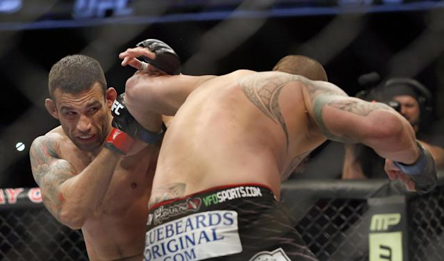 Fabricio Werdum, left, and Travis Browne fight during a UFC mixed martial arts bout on Saturday, April 19, 2014, in Orlando, Fla. Werdum won. (AP Photo/Reinhold Matay)