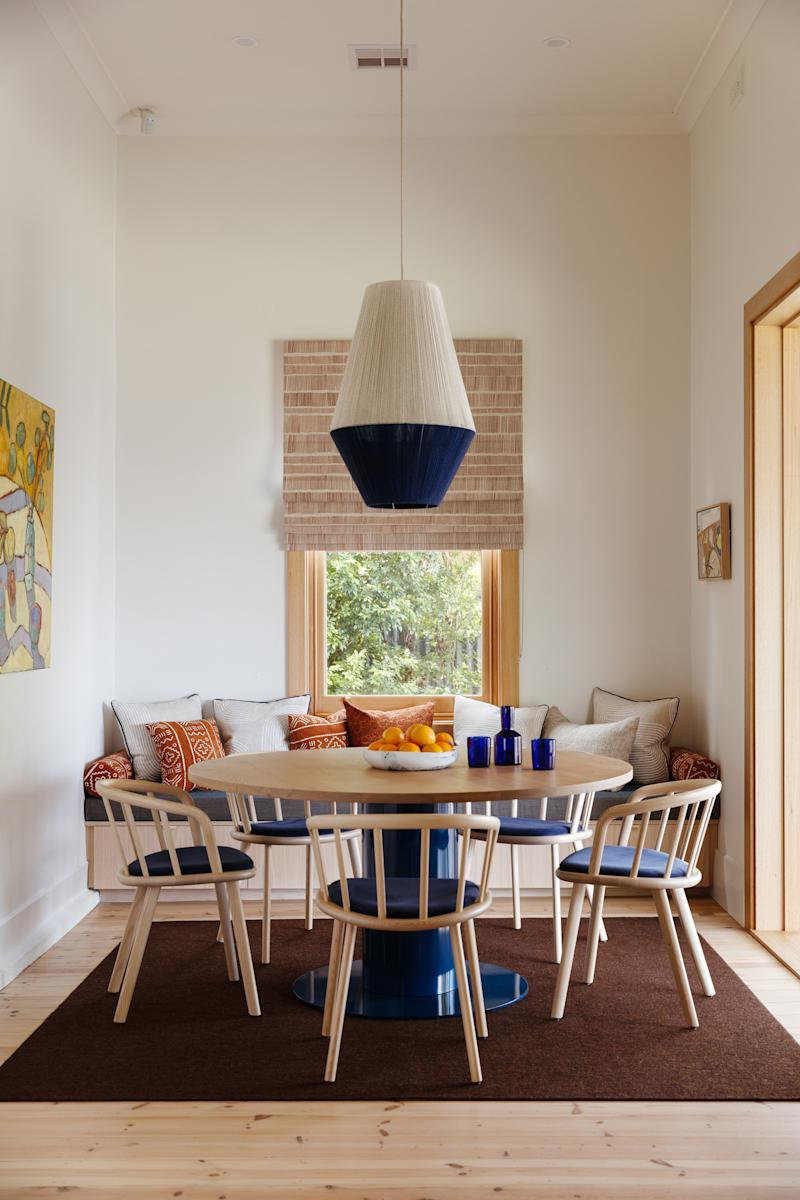 AFTER: The Fabrikate team widened and increased the height of the patio doors to let more natural light into the dining area. An Agostino & Brown Jam table, Pedrali Nym armchairs, and a Tretford square rug sit under a Dreamweaver pendant from Pop & Scott.