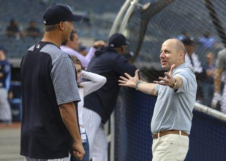 Jun 15, 2018; Bronx, NY, USA; Former New York Yankees pitcher Andy Pettitte (l) and general manager and senior vice president Brian Cashman (r) at Yankee Stadium prior to the game against Tampa Bay Rays. Mandatory Credit: Wendell Cruz-USA TODAY Sports
