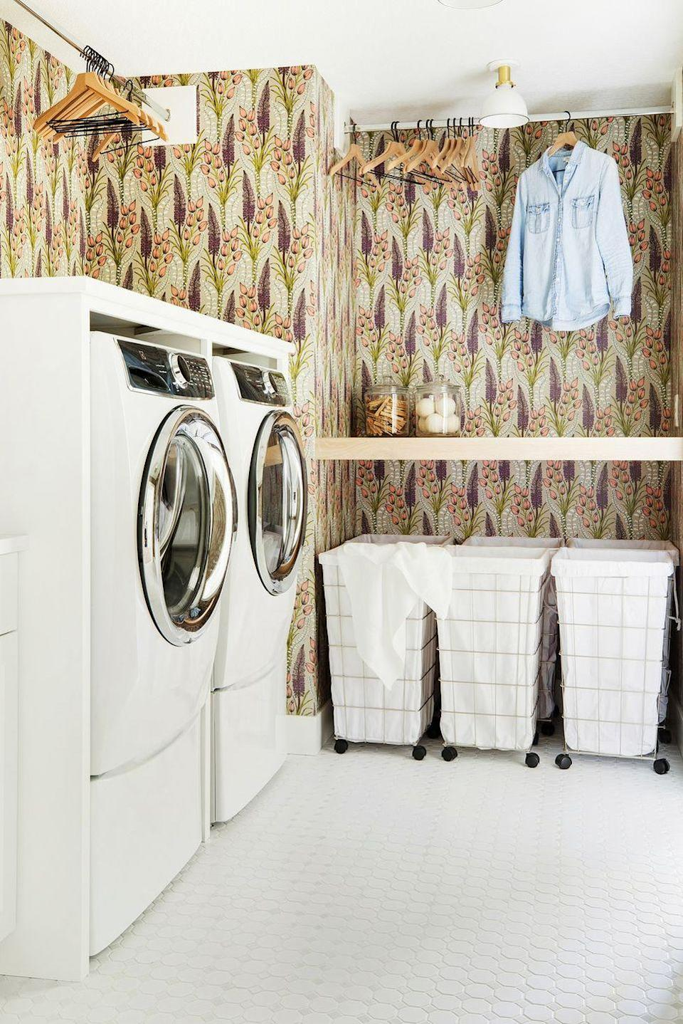 "<p>From graphic wallpaper to baskets on wheels, washing clothes won't ever feel like a chore if you <a href=""https://www.goodhousekeeping.com/home/organizing/g25572553/laundry-room-ideas/"" rel=""nofollow noopener"" target=""_blank"" data-ylk=""slk:give your laundry room the design attention"" class=""link rapid-noclick-resp"">give your laundry room the design attention</a> it deserves.<br></p>"