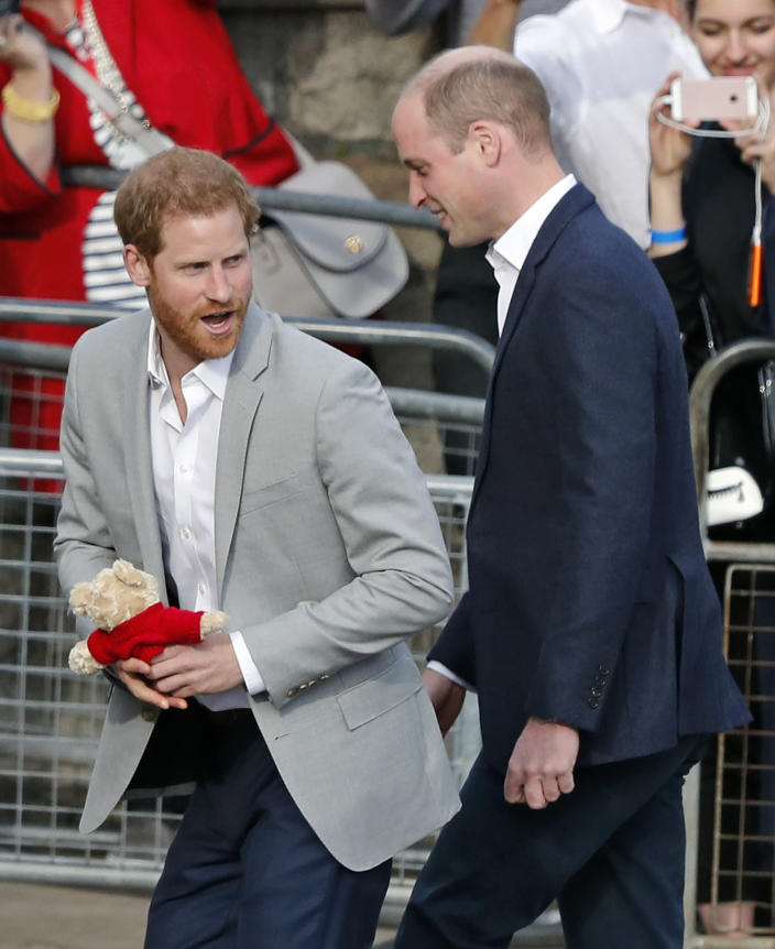 """FILE - In this file photo dated Friday, May 18, 2018, Britain's Prince William, right, and Prince Harry return to Windsor Castle after greeting crowds in Windsor, England. Prince Harry will attend the funeral for Prince Philip on Saturday April 17, and many observers believe that the funeral will provide an ideal opportunity for """"The Firm"""" to show a united front to the world and for the brothers to smooth over tensions.(AP Photo/Frank Augstein, FILE)"""