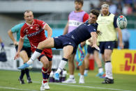 Scotland's Adam Hastings reaches for the ball as Russia's Ramil Gaisin, left, watches during the Rugby World Cup Pool A game at Shizuoka Stadium Ecopa between Scotland and Russia in Shizuoka, Japan, Wednesday, Oct. 9, 2019. (AP Photo/Christophe Ena)