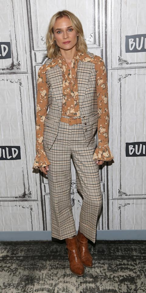 """<p>Diane Kruger gave us a lesson in mixing prints while wearing a plaid Michael Kors vest ($1,150; <a href=""""https://click.linksynergy.com/deeplink?id=93xLBvPhAeE&mid=25003&murl=https%3A%2F%2Fwww.neimanmarcus.com%2Fp%2Fmichael-kors-collection-plaid-stretch-wool-vest-prod222161128&u1=IS%2CLOTD071919-Kruger-Embed%2Ckchiello1271%2C%2CIMA%2C3466025%2C201907%2CI"""" target=""""_blank"""">neimanmarcus.com</a>) and pants with a floral long-sleeve blouse. Brown leather boots solidified her winning outfit.</p>"""