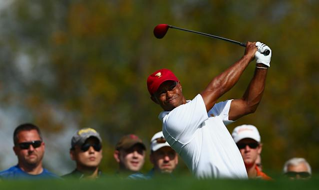 DUBLIN, OH - OCTOBER 01: Tiger Woods of the U.S. Team hits a shot during a practice round prior to the start of The Presidents Cup at the Muirfield Village Golf Club on October 1, 2013 in Dublin, Ohio. (Photo by Andy Lyons/Getty Images)