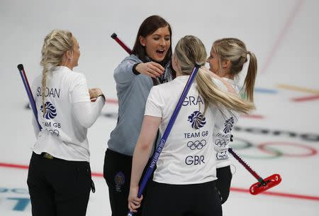 Curling - Pyeongchang 2018 Winter Olympics - Women's Round Robin - Britain v Canada - Gangneung Curling Center - Gangneung, South Korea - February 21, 2018 - Anna Sloan, Eve Muirhead, Vicki Adams and Lauren Gray of Britain celebrate after beating Canada. REUTERS/Phil Noble