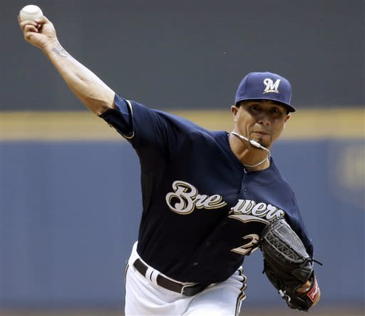 Milwaukee Brewers starting pitcher Kyle Lohse throws during the first inning of a baseball game against the Texas Rangers Wednesday, May 8, 2013, in Milwaukee. (AP Photo/Morry Gash)