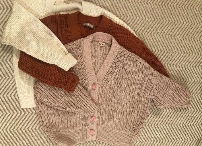 From left to right: Tradlands Shelter Cardigan, Everlane Cropped Cotton Cardigan and the cult-favourite Babaa no. 18 in plum blossom.
