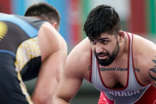 Amar Dhesi, of Surrey, B.C., won three of his four matches in the 125-kg round robin. The 25-year-old lost his final match to Kazakhstan's Yusup Batirmurzaev, but his wins earlier were enough to secure a gold medal in Rome, Italy.  (@WrestlingCanada/Twitter - image credit)