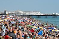 In the southern English resort of Brighton, people flocked to the beach on August 7, 2020 as temperatures soared