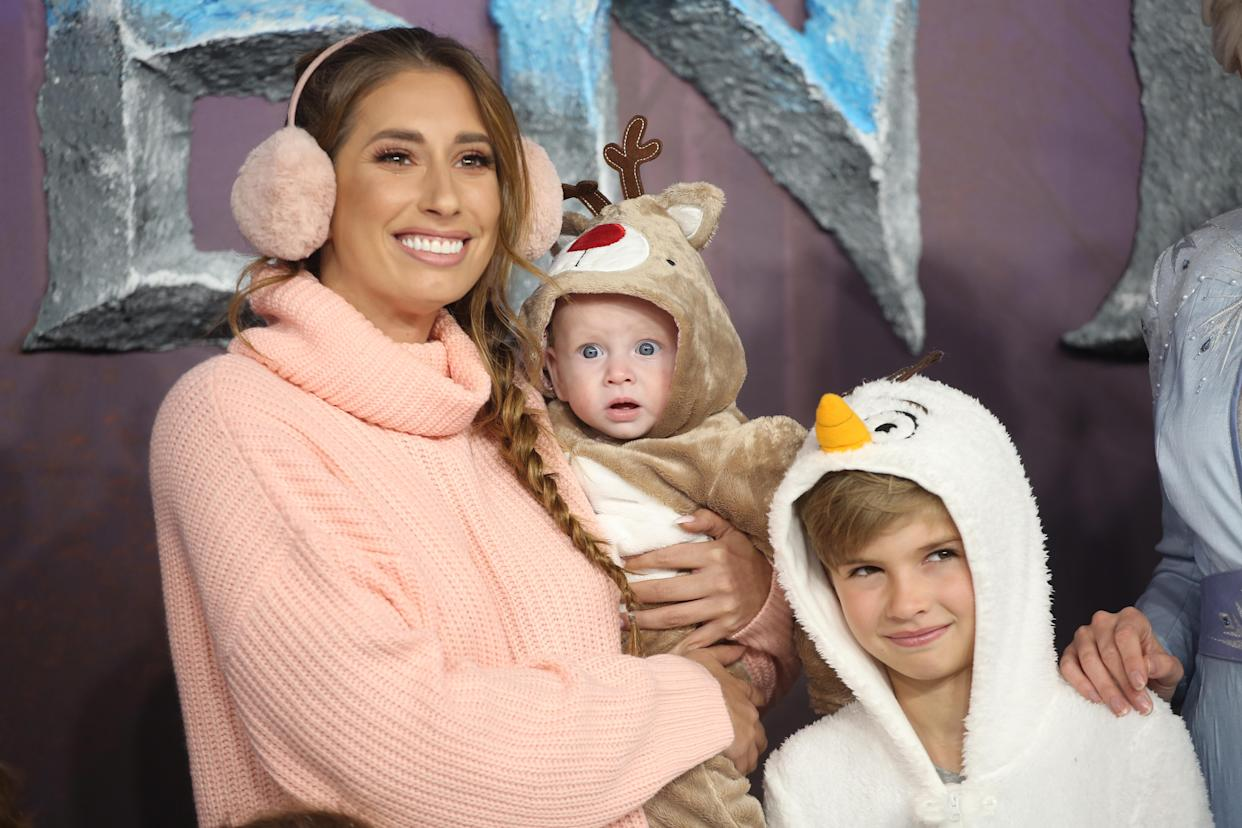 LONDON, ENGLAND - NOVEMBER 17: Stacey Solomon with her sons Rex Swash and Leighton Barham attend the