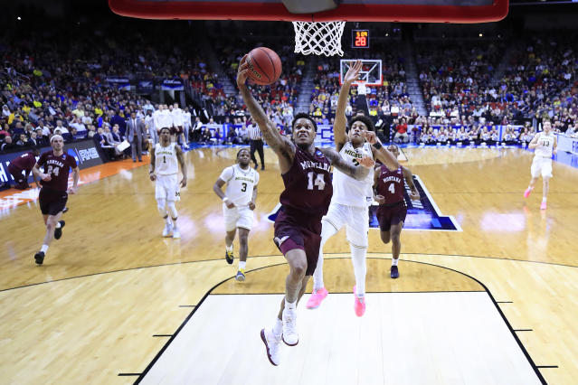 <p>Ahmaad Rorie #14 of the Montana Grizzlies drives to the basket against Jordan Poole #2 of the Michigan Wolverines in the first half during the first round of the 2019 NCAA Men's Basketball Tournament at Wells Fargo Arena on March 21, 2019 in Des Moines, Iowa. </p>