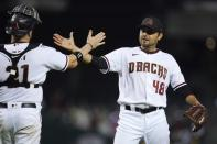 Arizona Diamondbacks relief pitcher Joakim Soria (48) celebrates with Diamondbacks catcher Stephen Vogt, left, after the final out of the ninth inning in a baseball game against the Milwaukee Brewers, Monday, June 21, 2021, in Phoenix. The Diamondbacks defeated the Brewers 5-1. (AP Photo/Ross D. Franklin)