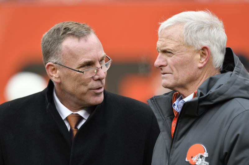Browns general manager John Dorsey, left, and team owner Jimmy Haslam have big decisions to make this week as the team looks to rebuild in the NFL draft. (AP)