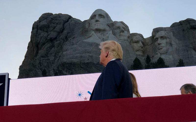 Donald Trump watches planes perform fly-overs of the Mt Rushmore National Monument - AP Photo/Alex Brandon