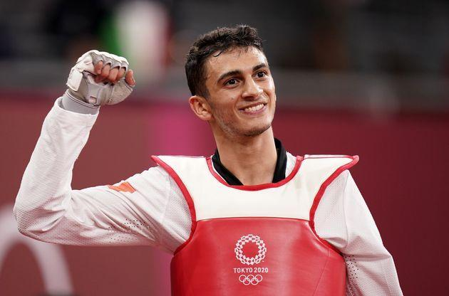 Italy's Vito Dell'Aquila celebrates victory against Tunisia's Mohamed Khalil Jendoubi to win the gold medal after their Men's Taekwondo 58kg Gold Medal contest at the Makuhari Messe on the first day of the Tokyo 2020 Olympic Games in Japan. Picture date: Saturday July 24, 2021. (Photo by Danny Lawson/PA Images via Getty Images) (Photo: Danny Lawson - PA Images via Getty Images)
