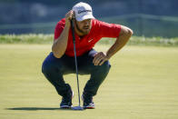 Matthew Wolff lines up a putt on the second green during the third round of the US Open Golf Championship, Saturday, Sept. 19, 2020, in Mamaroneck, N.Y. (AP Photo/John Minchillo)