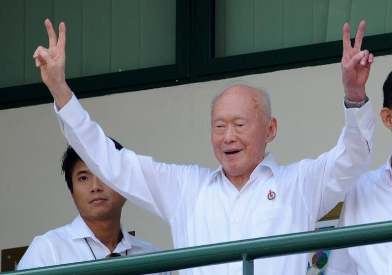 Lee Kuan Yew gives the victory sign to his supporters in Singapore on April 27, 2011