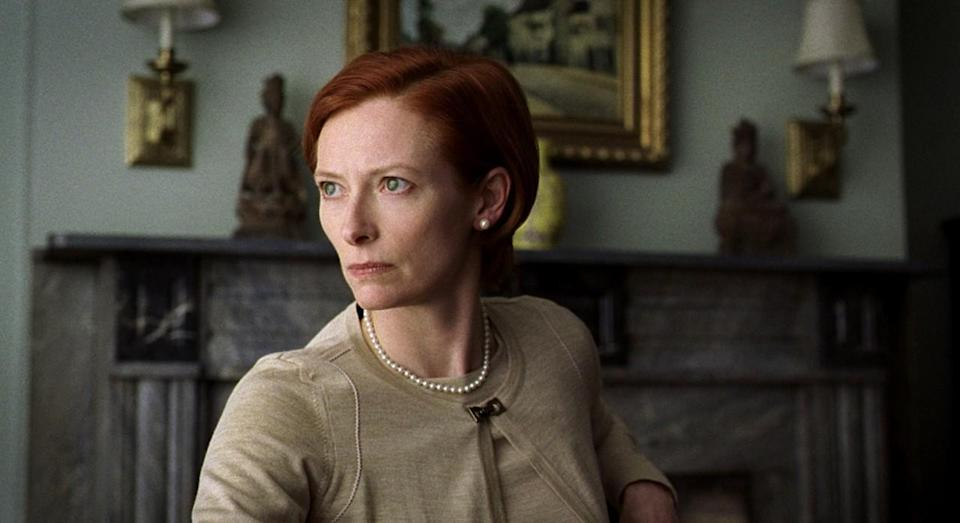 """<p>With her twin sets, skirt suits, rigid demeanor, and flawless bob haircut, Swinton perfected Katie Cox, the old money wasp who was very disappointed about the way her life turned out. """"She's just surrounded by bundling fools, but she's very efficient, very pissed off, and hasn't got any time to lose,"""" Swinton has said of the role. </p>"""