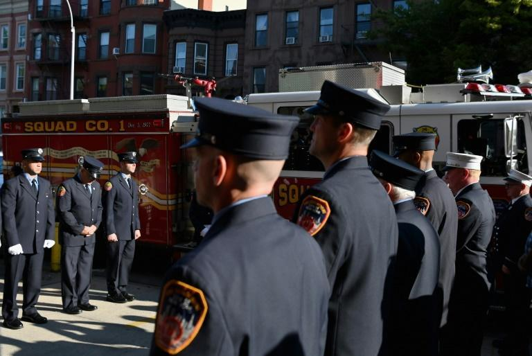 Firefighters in Brooklyn, New York observe a moment of silence on September 11, 2021 to mark those lost in the terror attacks 20 years earlier (AFP/ANGELA WEISS)
