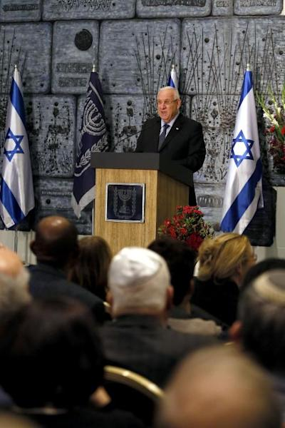 Israeli President Reuven Rivlin speaks during the first ceremony to mark the Day of Commemoration for Jewish Refugees from Arab countries and Iran at the presidential compound in Jerusalem on November 30, 2014