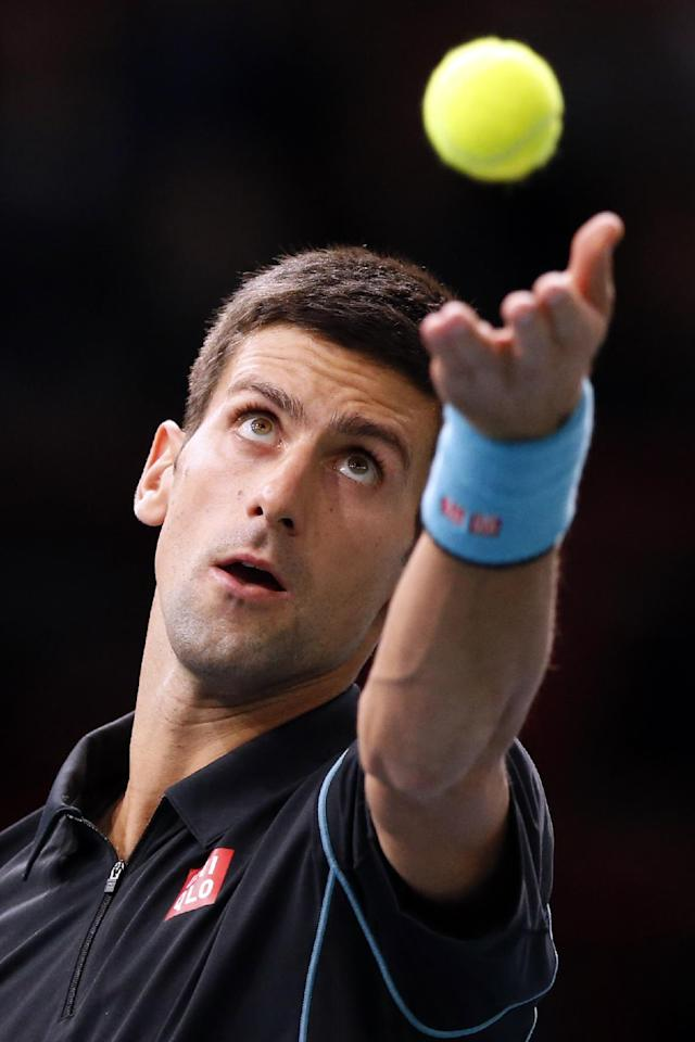 Novak Djokovic of Serbia serves the ball to France's Pierre-Hugues Herbert, during their second round match, at the Paris Masters tennis at Bercy Arena in Paris, France, Tuesday, Oct. 29, 2013. (AP Photo/Francois Mori)
