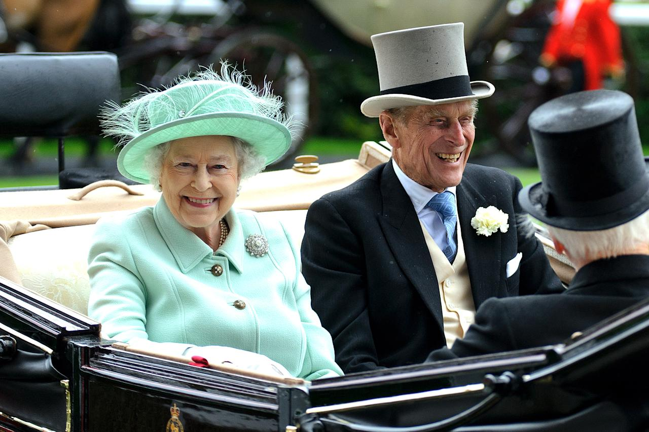 ASCOT, ENGLAND - JUNE 21:  (L-R) Queen Elizabeth II and Prince Philip, Duke of Edinburgh attends Ladies Day during Royal Ascot at Ascot Racecourse on June 21, 2012 in Ascot, England.  (Photo by Ben Pruchnie/Getty Images)