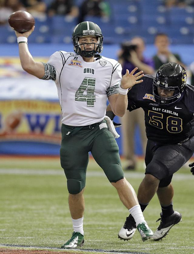 Ohio quarterback Tyler Tettleton (4) throws a pass after rolling away from East Carolina defensive end Lee Pegues (58) during the first quarter of the Beef 'O' Brady's Bowl NCAA college football game Monday, Dec. 23, 2013, in St. Petersburg, Fla. (AP Photo/Chris O'Meara)
