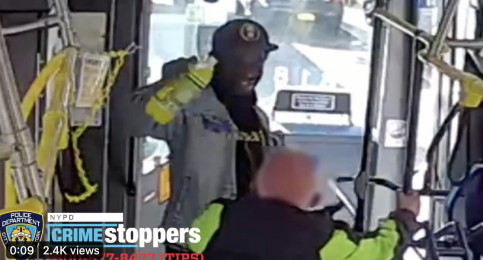Security footage of the suspect on the bus  pouring a bright green drink over an elderly man's  head.