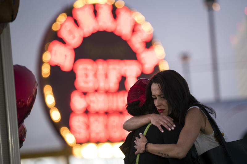 Two women hug at a makeshift memorial at the northern end of the Last Vegas Strip on Wednesday.  (Drew Angerer via Getty Images)