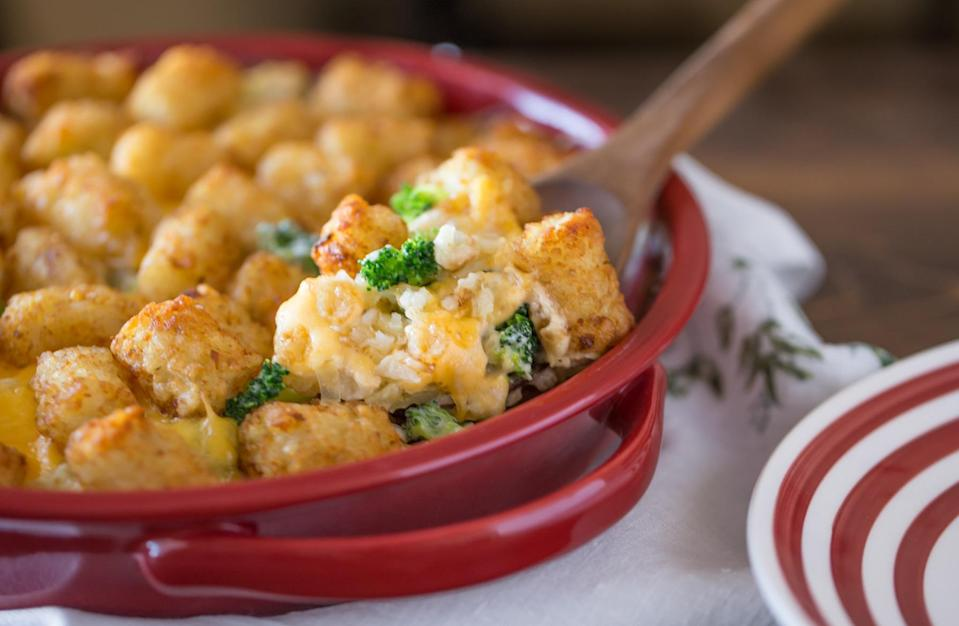 """<p>If you don't cook your vegetables with cheese and cream, can you really even call yourself a Midwesterner? An additional surprise ingredient on top gives this <a href=""""https://www.thedailymeal.com/cook/unbelievable-retro-recipes-gallery?referrer=yahoo&category=beauty_food&include_utm=1&utm_medium=referral&utm_source=yahoo&utm_campaign=feed"""" rel=""""nofollow noopener"""" target=""""_blank"""" data-ylk=""""slk:classic casserole dish"""" class=""""link rapid-noclick-resp"""">classic casserole dish</a> a satisfying crunch.</p> <p><em><a href=""""https://www.thedailymeal.com/recipes/cheesy-broccoli-tater-topped-casserole-recipe?referrer=yahoo&category=beauty_food&include_utm=1&utm_medium=referral&utm_source=yahoo&utm_campaign=feed"""" rel=""""nofollow noopener"""" target=""""_blank"""" data-ylk=""""slk:For the Cheesy Broccoli Tater-Topped Casserole recipe, click here."""" class=""""link rapid-noclick-resp"""">For the Cheesy Broccoli Tater-Topped Casserole recipe, click here.</a></em></p>"""