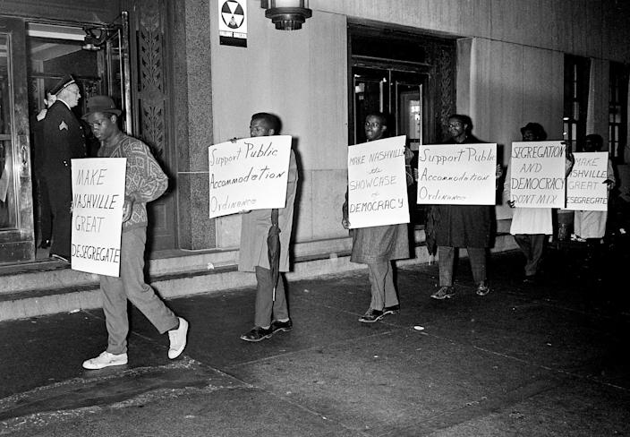 John Lewis, national chairman of the Student Non-Violent Coordinating Committee, second from left, marches with other students in Nashville.
