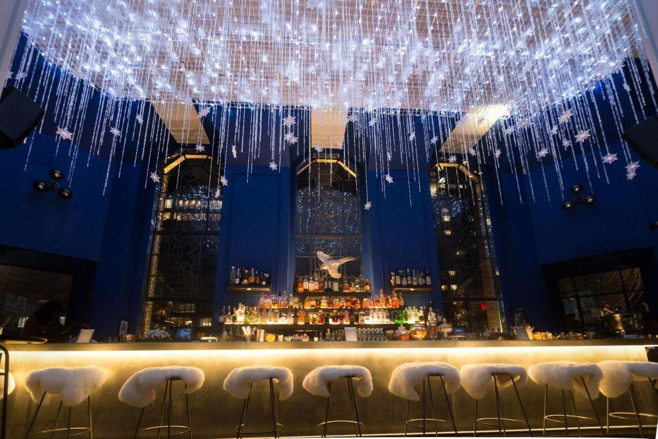 """<p>The greenhouse terrace bar <a href=""""https://opheliany.com"""" rel=""""nofollow noopener"""" target=""""_blank"""" data-ylk=""""slk:Ophelia"""" class=""""link rapid-noclick-resp"""">Ophelia</a> at the top of the Beekman Tower transforms its 360-degree Manhattan views into a glittering snow globe again this holiday season with gleaming strands of snowflakes and lights strung from the ceiling and wintery touches like garlands and sheepskin seat covers. Wintery cocktails like the Rising Star with cognac, rum, cinnamon, and lotus cookie infused cream will feature as well as desserts like churros. </p><p><em>Open through February 28, 2020. Beekman Tower, 3 Mitchell Place.</em></p>"""