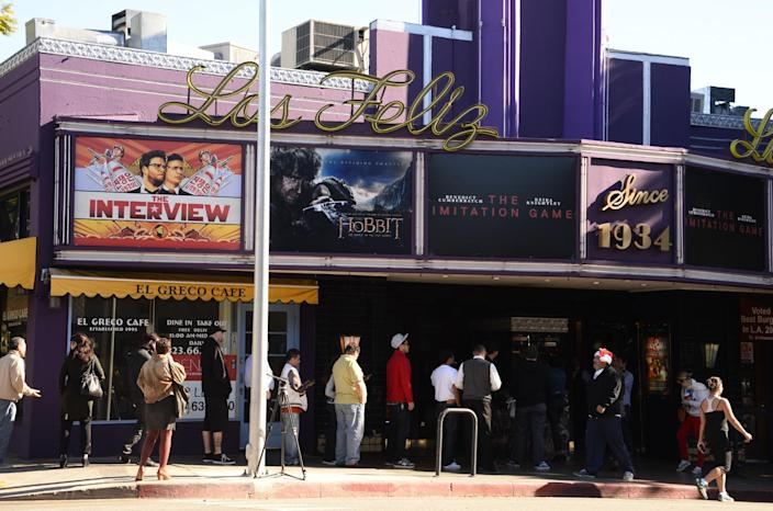 """The poster for the movie """"The Interview,"""" December 25, 2014, is seen on the marquee of the Los Feliz 3 cinema in Los Angeles, California. (AFP Photo/Robyn Beck)"""