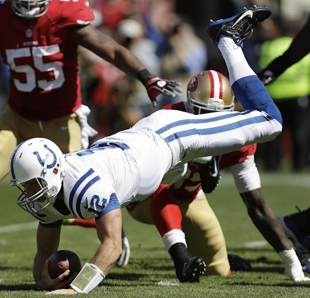Indianapolis Colts quarterback Andrew Luck (12) is tackled by San Francisco 49ers linebacker Aldon Smith, rear, during the first quarter of an NFL football game in San Francisco, Sunday, Sept. 22, 2013. (AP Photo/Marcio Jose Sanchez)