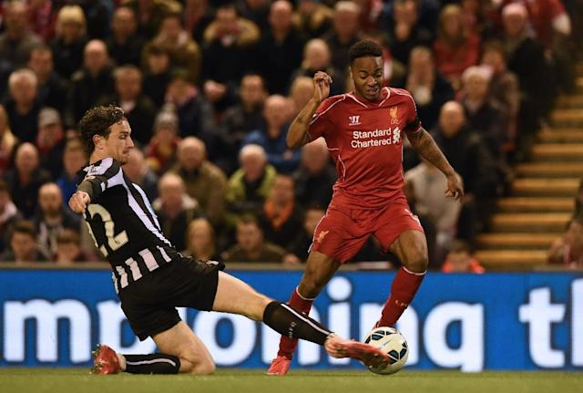 Newcastle United's defender Daryl Janmaat (L) vies with Liverpool's midfielder Raheem Sterling during the English Premier League football match at Anfield in Liverpool on April 13, 2015 (AFP Photo/Paul Ellis)