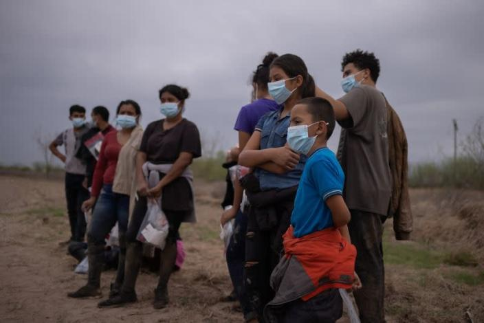 Migrants from Central America await transport after crossing into the U.S. from Mexico on a raft in Penitas