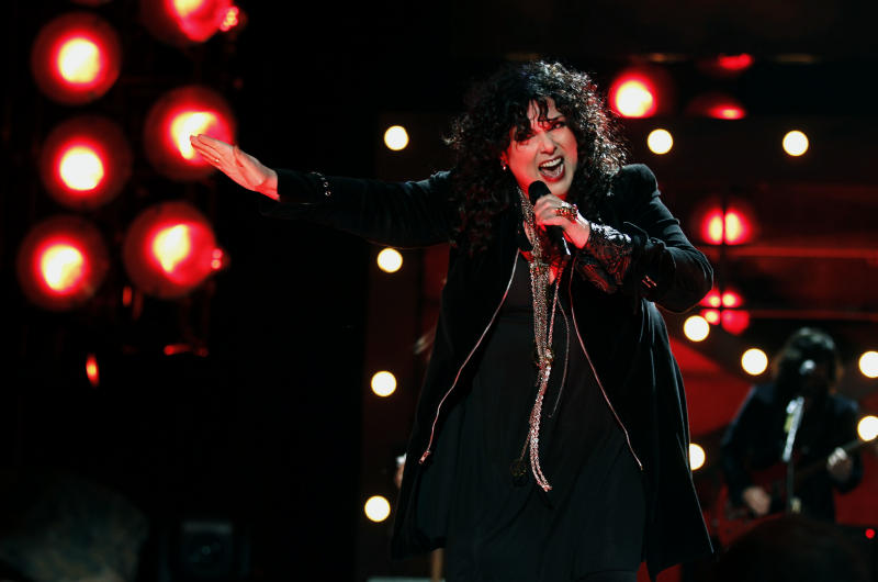 "FILE - In this Dec. 3, 2010, file photo, Ann Wilson of the band Heart performs onstage at the ""Vh1 Divas Salute the Troops"" on in San Diego, Calif. The husband of Heart lead singer Ann Wilson has been sentenced for allegedly choking her nephews during a concert in suburban Seattle. Seattlepi.com reported Friday, April 14, 2017, that Dean Wetter pleaded guilty March 9 to two counts of assault. He was sentenced as part of a plea deal to 364 days in jail, with all the time suspended.  (AP Photo/Matt Sayles, File)"