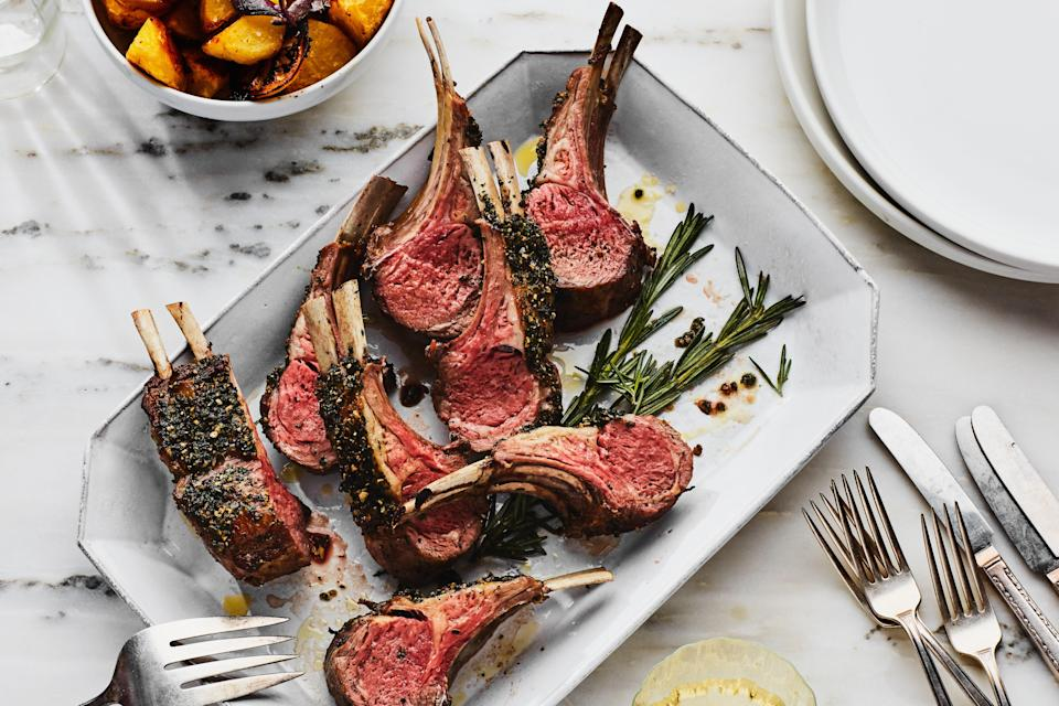 """Herb-and-bread-crumb coatings are classic on rack of lamb, but leaving out the crumbs lightens the dish (and the juicy chops taste more summery as a result). This recipe is best made with new garlic—garlic that has not been aged. It is covered with a moist membrane rather than papery skin and is often sold with greens attached. If you're lucky enough to find some, substitute 1/4 cup chopped garlic greens for half of the parsley in the herb mixture. <a href=""""https://www.epicurious.com/recipes/food/views/rack-of-lamb-with-garlic-and-herbs-1222178?mbid=synd_yahoo_rss"""" rel=""""nofollow noopener"""" target=""""_blank"""" data-ylk=""""slk:See recipe."""" class=""""link rapid-noclick-resp"""">See recipe.</a>"""