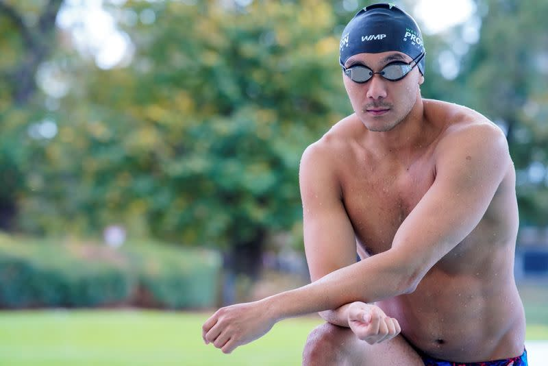 Myanmar swimmer Win Htet Oo poses for a portrait at a pool in Melbourne