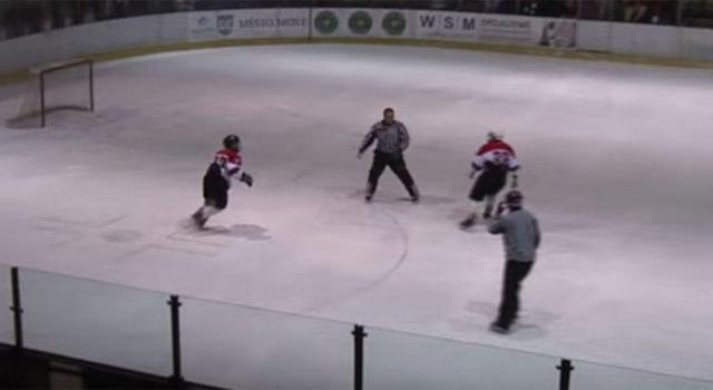 A referee is chased down by a pair of teen hockey players. (Screen grab via YouTube)