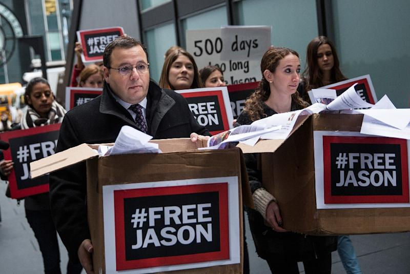 Ali Rezaian, the brother of Washington Post journalist Jason Rezaian, protests with supporters before delivering a petition to the Iranian Mission to the United Nations calling for his brother's immediate release on December 3, 2015 in New York City (AFP Photo/Andrew Burton)