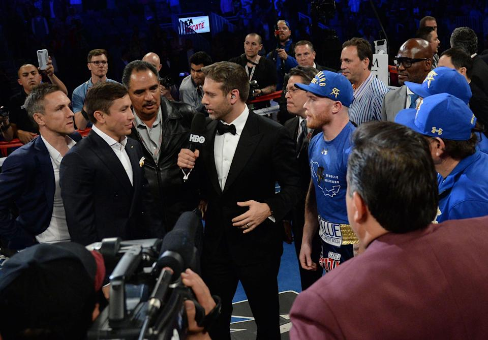 Canelo Alvarez (right) and Gennady Golovkin (left) are interviewed by Max Kellerman (middle) to promote their September bout at T-Mobile Arena. Alvarez won via unanimous decision.