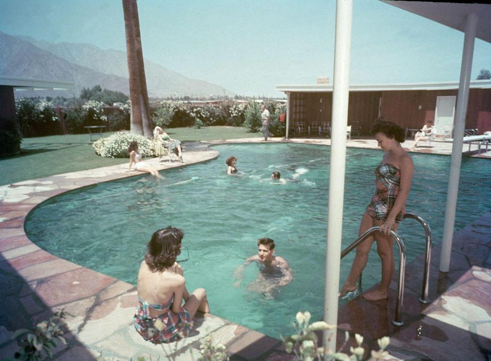 """<p>Frank Sinatra began construction on his Palm Springs home in 1947. The famous crooner commissioned E. Stewart Williams to design the modern ranch home, known as Twin Palms, which featured a <a href=""""https://www.wnyc.org/story/house-i-live-frank-sinatra-palm-springs/"""" rel=""""nofollow noopener"""" target=""""_blank"""" data-ylk=""""slk:large piano-shaped pool outside"""" class=""""link rapid-noclick-resp"""">large piano-shaped pool outside</a>. </p>"""