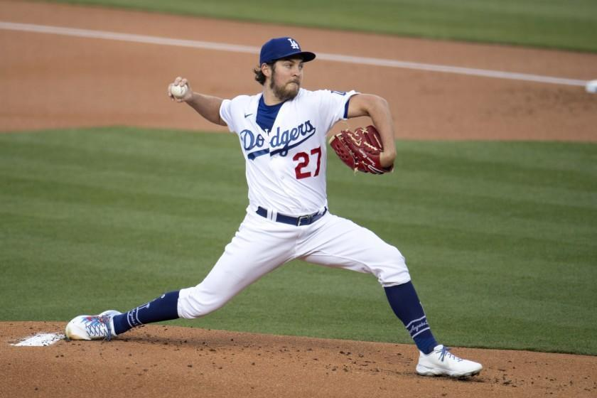 Los Angeles Dodgers starting pitcher Trevor Bauer winds up during the first inning of the team's baseball game.