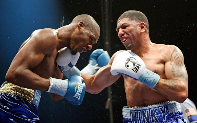 Winky Wright (L) lands a punch on Paul Williams during their April 11, 2009, bout in Las Vegas. Wright was elected to the International Boxing Hall of Fame on Tuesday. (Getty Images)
